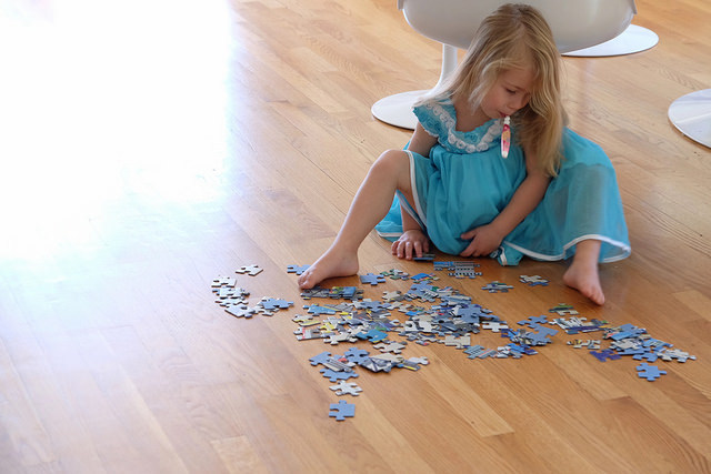 Jigsaw Puzzles on Hardwood Flooring